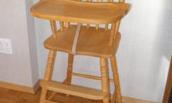 Solid birch high chair, purchased from Alberta Wood Products.  Very sturdy, nice piece of furniture.  Perfect when the grandkids come visit.