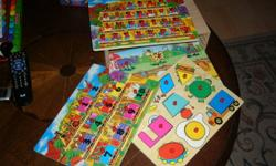 4 Wooden puzzles with wooden case for them.Not missing any peices. like new .smoke free home. son out grew them. letters, numbers, animals and shapes 5.00 firm5196836265