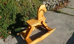 This is a child's rocking horse. It is 35 inches long, 17 1/2 inches wide and 29 inches tall. It appears to be made of solid pine.