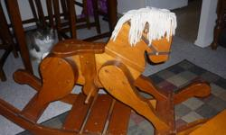 Wooden Rocking Horses of this type sell anywhere from $400 - $700   You can get a GREAT deal and buy this one today for someone special for only $75.00 or best offer. It is in greeat condition, it's solid and looks great. It has been used and at one point