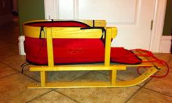 Solid wood sled ! Half hoop railings support child's back and sides. Runners have steel runner bars to help the sled track straight while protecting wood. Capable for supporting up to 60 lbs. Tow rope and water resistant seat pad. Purchased from lee