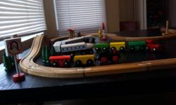 Wooden train set, tracks, 3 trains, people,signs and trees all wooden and wonderful nostalgic toy for children. You don't have to worry about your child playing with harmful plastics with beautiful wooden toys. Also available second set of wood tracks