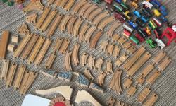 This will be the best toy you could ever get for your children or grandchildren. We are selling our complete set of wooden tracks and all the stuff to go with them. There are 75 tracks, assorted trains (36 in total), three bridges, tunnel, a roundhouse, a
