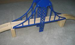 GENTLY USED WOODEN SUSPENSION BRIDGE.   CAN BE USED WITH ANY WOODEN TRAIN SET INCLUDING THOMAS & FRIENDS.   INCLUDES ASCENDING AND DESCENDING TRACK AS WELL AS SUPPORTS