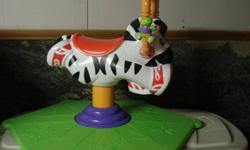 Spinning Zebra- With music ·         Excellent condition ·         Spins ·         Twirls ·         Rocks back and forth ·         Plays music ·         Has toys ·         Doesn?t take up much room ·         Tons of fun!!!