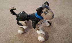 Electronic trainable doggy. Original packaging and manuals etc. Great shape.